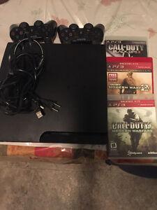 ps3 slim with controllers and games. London Ontario image 1