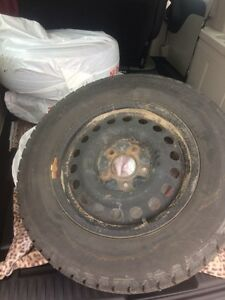 4 Grand Caravan studded winter tires with rims