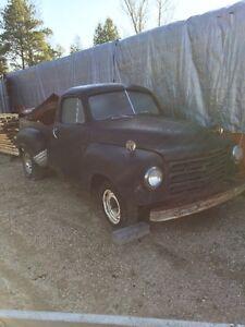 two 1953 studebaker trucks