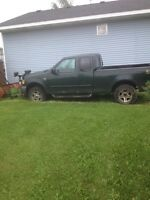 2002 Ford f150 4x4 with boss snow plow.