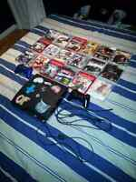 Ps3 120 GB with 2 controllers 2 charge cables & 18 games