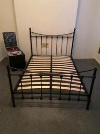 48. Black metal double bed frame