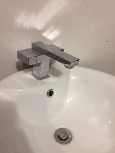 "Used: Modern ""vessel"" style sink and faucet."