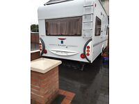 German built fixed bed 4 berth light weight 2007 with awning