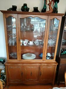 Antique china cabinet with dining room table and six chairs