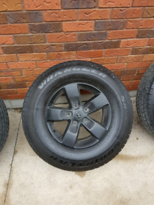 """Almost new 17"""" ram rims and tires"""