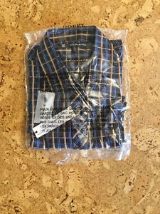 New, tag attached men's tops and sweaters