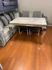 10. Grey marble table and 4 grey leather chairs