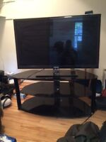 Tv stand. Black solid glass for corner