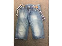 Boys longer length shorts with braces.