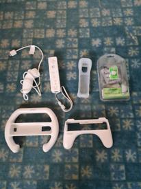 Wii remote/ wii Nunchuk/ 2 Nintendo wheels