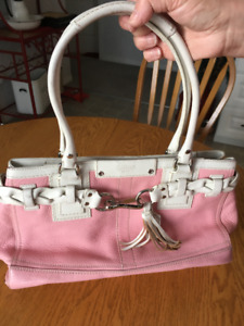 Pink and white coach purse.