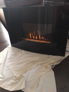 Bionaire Electric Wall Mount Fireplace. 6 settings for timer