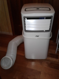 ARCTIC KING AIR CONDITIONER WITH WARRANTY