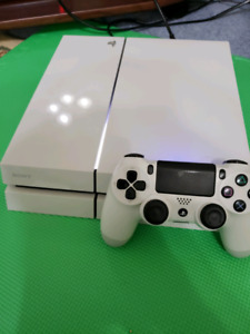 white ps4 500gb with controller and 2 games