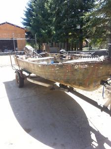 14ft aluminum multi species\ purpose fishing boat.