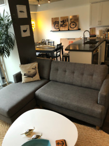 Stylish, grey, mint-condition couch