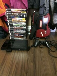 Ps2 with GH guitar, controller, memory card and 21 games