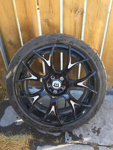 "18"" Montegi racing rims on tires"