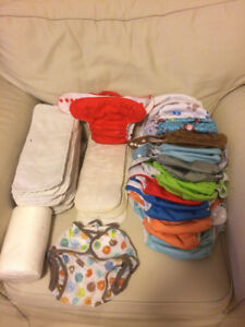 23 Cloth diapers & roll of biodegradable liners