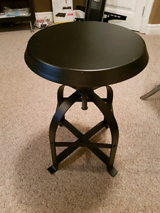 Adjustable black metal stool