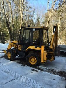 Compact backhoe for hire