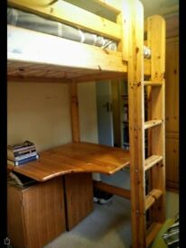 Flexa high rise pine single bed with desk underneath.