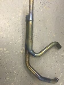 Decatted stock exhaust for Harley touring