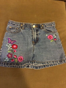 Girls (youth) size 8 jean shorts with embroidered patches