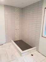 Ceramic tile installer or helper