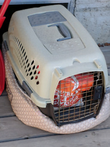 Small pet carrier , bed , and bag of food
