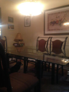 6' x 3.5' Glass and bronze metal dining room set.  $250