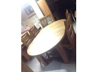 Solid oak oval table and chairs new large