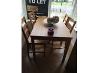 Table with four chairs due to moveing and no where for it