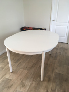 White dining table seats up to 8