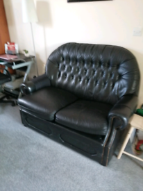 2 seater black leather Chesterfield sofa