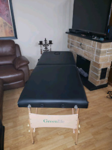 Portable massage table with framed massage charts
