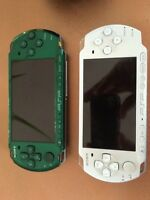 2 Sony PSPs, 12 games, case, charger and 2 memory cards