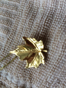 Gold encrusted maple leaf with chain
