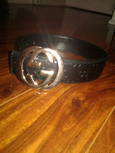 100% authentic black and gold gucci belt size 30-36