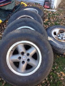 """235/75/15 tires on 15"""" rims x    4 with spare"""