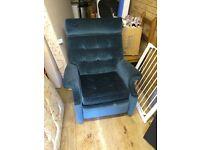 Green velour reclining Parker Knoll chair