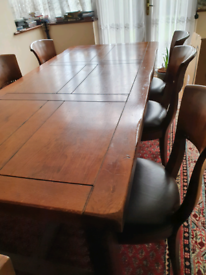 Solid oak dining table and 6 chairs