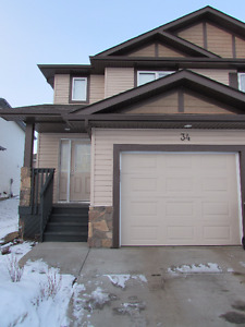 Your Family Will LOVE This Stony Plain 3 Bed Duplex + Garage
