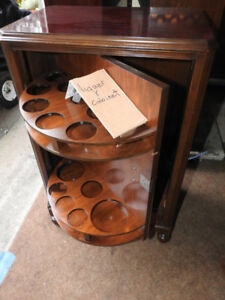 small antique liquor cabinet... interesting design...