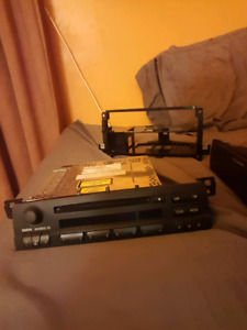 Bmw e46 oem radio and rack 80$ not negotiable thank you