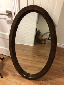 Wooden oval wall mirror