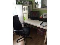 Desk with chair and computer