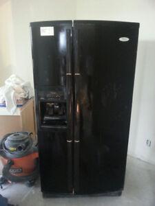 Black Whirlpool side-by-side refrigerator