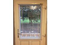 White Venetian door blind